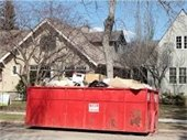 Dumpster in front of house